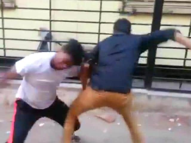 An-image-grab-taken-from-a-YouTube-video-shows-the-fist-fight-between-two-students-in-Hyderabad