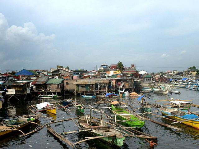 Fishing-outrigger-boats-are-anchored-at-the-mouth-of-a-river-feeding-Manila-Bay-as-the-Philippine-coast-guard-banned-sailing-due-to-nearby-Typhoon-Noul-in-the-northern-part-of-the-country-AFP-Photo