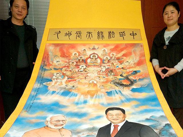Jinke-Yindang-and-Jinke-Yinduan-hold-painting-of-PM-Narendra-Modi-and-China-s-President-Xi-Jinping-HT-Photo