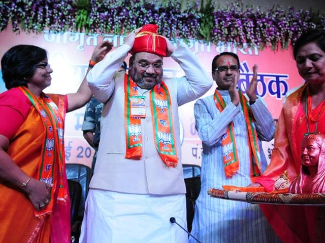 BJP-president-Amit-Shah-being-welcomed-during-the-national-executive-committee-meeting-of-the-BJP-Mahila-Morcha-at-the-state-BJP-office-in-Bhopal-on-Sunday-Mujeeb-Faruqui-HT-photo