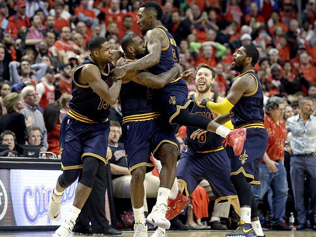 Cleveland-Cavaliers-LeBron-James-celebrates-with-Tristan-Thompson-J-R-Smith-Matthew-Dellavedova-and-Kyrie-Irving-after-scoring-the-game-winning-basket-during-the-second-half-of-Game-4-in-a-second-round-NBA-basketball-playoff-series-against-the-Chicago-Bulls-in-Chicago-The-Cavaliers-won-86-84-AP-Photo