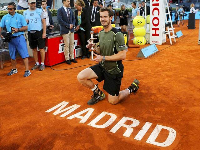 Andy-Murray-of-Britain-poses-for-photographers-while-holding-the-winners-trophy-after-defeating-Rafael-Nadal-of-Spain-in-their-men-s-singles-final-match-at-the-Madrid-Open-Tennis-tournament-in-Madrid-Spain-AP-PHOTO
