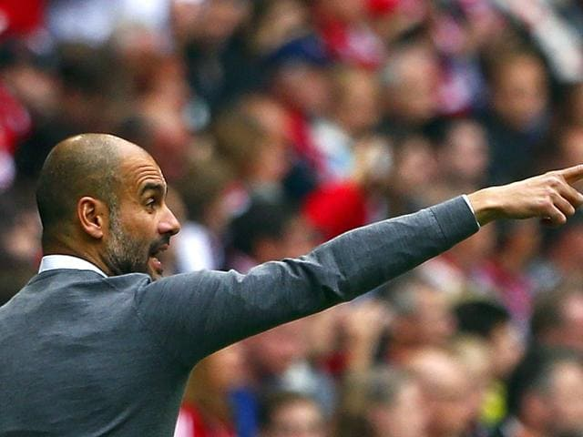 Bayern-Munich-s-coach-Pep-Guardiola-gestures-during-the-German-Bundesliga-first-division-soccer-match-against-Augsburg-in-Munich-Germany-REUTERS