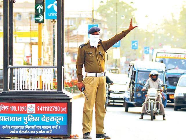 A-policeman-manages-traffic-in-Dehradun-HT-Photo