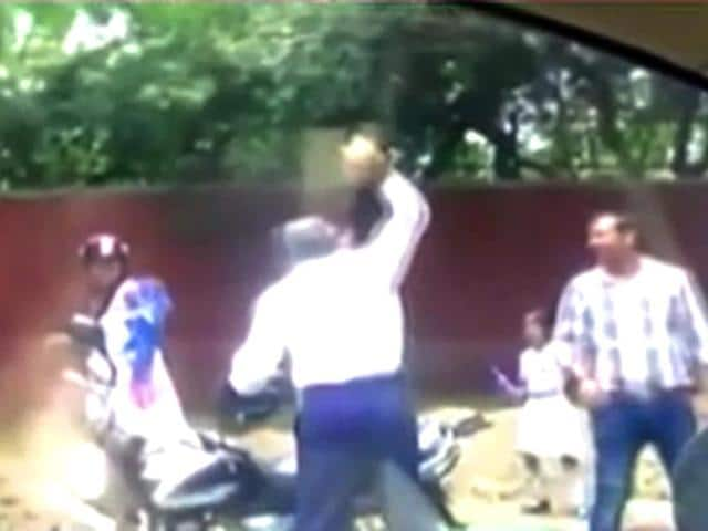 A-Delhi-Police-constable-was-caught-on-camera-hurling-a-stone-at-a-woman-Photo-Aaj-Tak-s-YouTube-channel