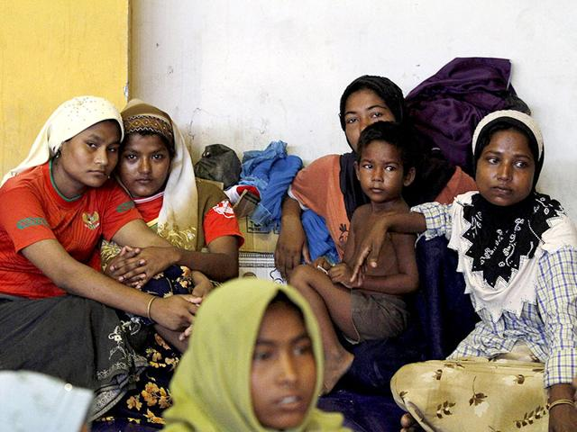 Migrants-believed-to-be-Rohingya-eat-inside-a-shelter-after-being-rescued-from-boats-in-Lhoksukon-Indonesia-s-Aceh-Province-Reuters-Photo