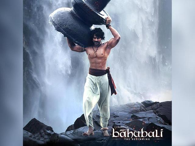 Baahubali (Prabhas) carries a massive lingam in this poster from SS Rajamouli