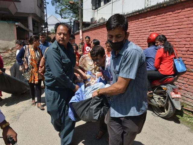 A-file-photo-of-Nepalese-patients-being-carried-out-of-a-hospital-building-when-the-7-4-magnitude-earthquake-rocked-the-country-AFP-Photo