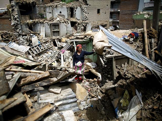 A-woman-stands-on-the-debris-of-collapsed-houses-in-Sankhu-Nepal-Reuters-Photo