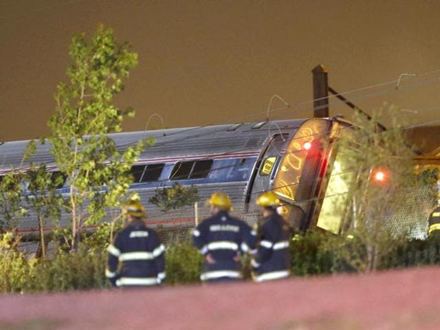 Emergency-personnel-work-at--the-scene-of-a-wreck-of--an-Amtrak-train--that--derailed-and-crashed-in-Philadelphia-AP-Photo