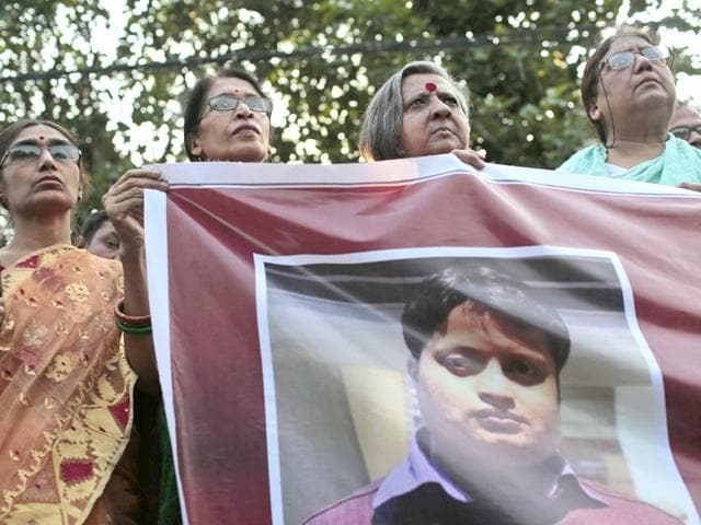 Social-activists-hold-a-banner-of-blogger-and-author-Ananta-Bijoy-Das-during-a-protest-against-his-killing-in-Dhaka-Bangladesh-AP-Photo