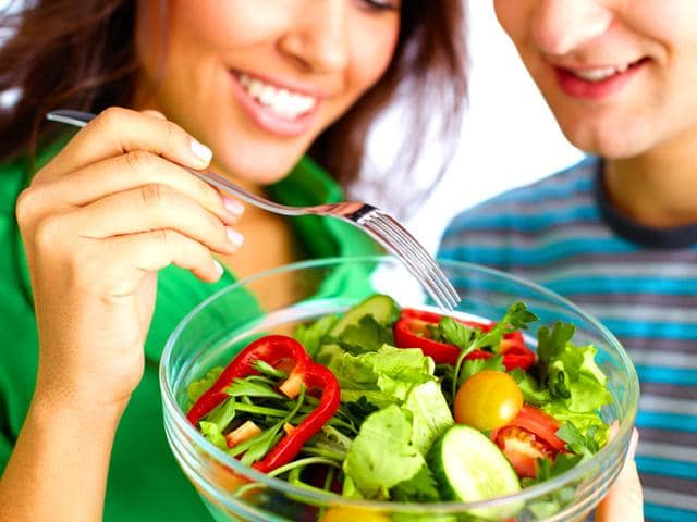 A-psychological-effect-known-as-social-modelling-leads-people-to-eat-less-than-they-normally-would-if-alone-Shutterstock