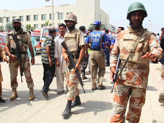Pakistani-paramilitary-troops-stand-guard-outside-a-local-hospital-following-an-attack-on-a-bus-in-Karachi-Pakistan-AP-Photo