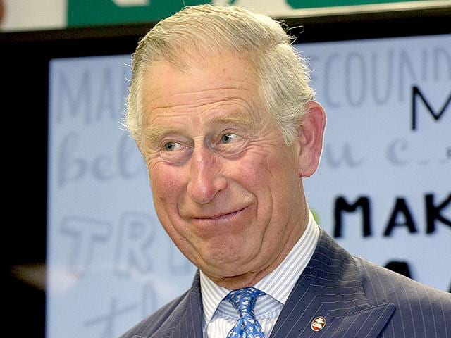 Britain-s-Prince-Charles-smiles-as-he-hands-out-certificates-to-Prince-s-Trust-Mark-your-Mark-participants-during-a-visit-to-British-retailer-Marks-and-Spencer-in-London-AP-Photo