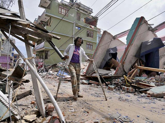 A--woman-stands-amid-the-debris-caused-by-a-fresh-earthquake-in-Nepal-Burhaan-Kinu-HT-Photo