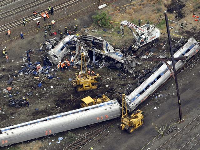 Emergency-workers-look-through-the-remains-of-a-derailed-Amtrak-train-in-Philadelphia-Pennsylvania-Rescue-workers-on-Wednesday-sifted-through-twisted-metal-and-debris-from-the-wreck-of-the-Amtrak-train-that-derailed-in-Philadelphia-killing-six-people-and-injuring-scores-of-others-as-investigators-began-reviewing-data-to-determine-the-cause-of-an-accident-Reuters-Photo