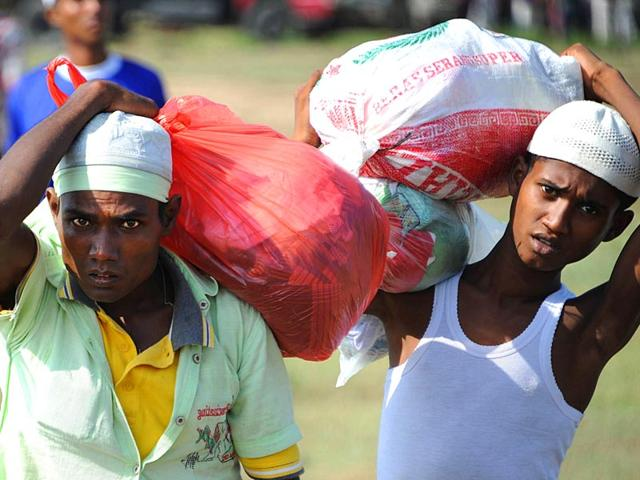 Rescued-migrants-mostly-Rohingyas-from-Myanmar-and-Bangladesh-arrive-in-Aceh-province-after-the-migrants-numbering-nearly-600-were-relocated-by-Indonesian-authorities-from-a-government-stadium-Malaysia-joined-Indonesia-on-May-13-in-vowing-to-turn-back-vessels-bearing-a-wave-of-migrants-drawing-warnings-that-the-hardline-policy-could-be-a-death-sentence-for-boatloads-of-people-at-risk-of-starvation-and-disease-AFP-Photo