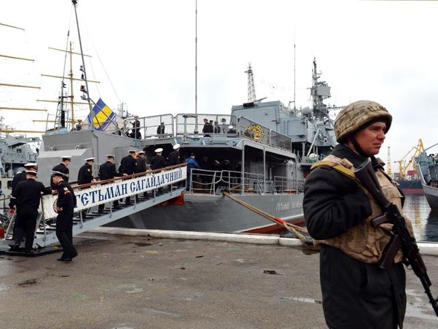 Ukrainian-sailor-stands-guard-in-front-of-a-naval-frigate-Hetman-Sahaydachniy-Odessa-Ukraine-AFP-Photo