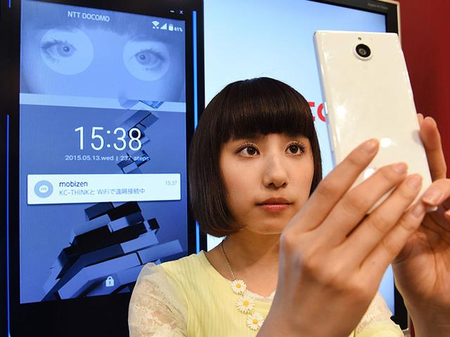 A-model-for-Japan-s-mobile-communication-giant-NTT-Docomo-demonstrates-unlocking-the-company-s-new-Arrows-NX-F-04Q-smartphone-with-an-iris-scan-during-a-press-preview-in-Tokyo-Photo-AFP
