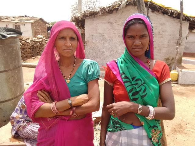 Two-tribal-women-show-off-their-wrist-watches-HT-photo