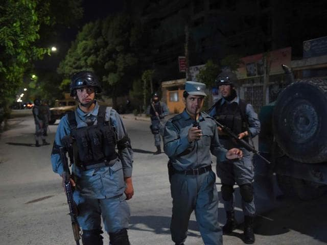 Afghan-security-forces-stand-guard-at-the-site-of-an-attack-in-Kabul-May-13-2015-Gunmen-stormed-a-building-in-an-upmarket-area-of-the-Afghan-capital-Kabul-on-Wednesday-night-and-shooting-was-continuing-an-army-commander-said-Reuters-Photo