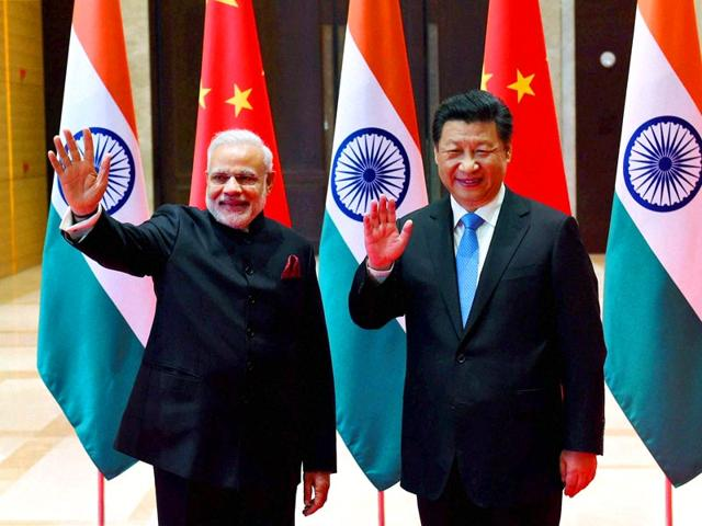 In-this-handout-photograph-taken-and-released-by-The-Indian-Press-Information-Bureau-PIB-Prime-Minister-Narendra-Modi-leads-his-delegation-in-talks-with-Chinese-President-Xi-Jinping-at-The-Shaanxi-Guest-House-in-Xi-an