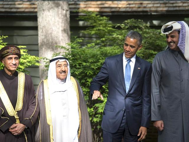 US-President-Barack-Obama-2nd-R-chats-with-the-emir-of-Qatar-Sheikh-Tamim-bin-Hamad-al-Thani-R-the-emir-of-Kuwait-Sheikh-Sabah-al-Ahmed-al-Sabah-2nd-L-and-Oman-s-deputy-Prime-Minister-Fahd-bin-Mahmud-al-Said-L-as-they-prepare-to-pose-for-the-family-photo-during-a-summit-meeting-at-Camp-David-in-Maryland--AFP-Photo