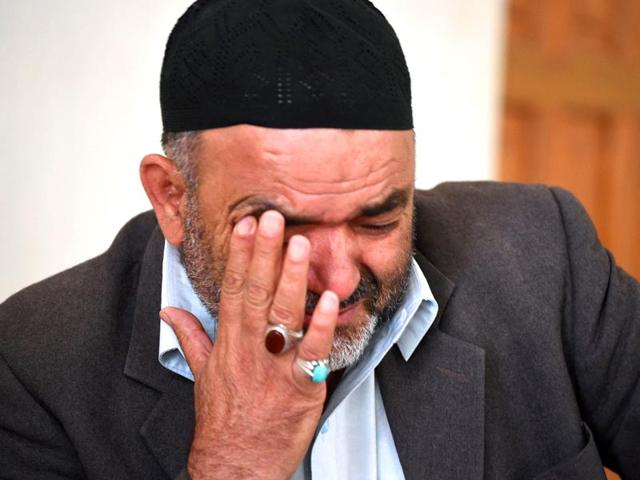 This-file-photo-shows-Pakistani-Shiite-Muslim-Syed-Qurban-reacting-as-he-speaks-during-an-interview-at-his-residence-in-Quetta-of-his-son-Ali-Raza-who-was-drowned-after-boarding-a-ship-going-illegally-to-Australia-Sectarian-violence-in-particular-by-Sunni-hardliners-against-Shiites-who-make-up-roughly-20-of-Pakistan-s-200-million-people-has-claimed-thousands-of-lives-in-the-country-over-the-past-decade---AFP-Photo-