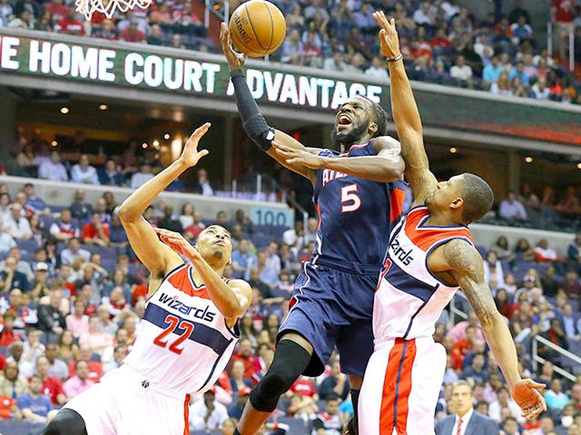 Atlanta-Hawks-Demarre-Carroll-draws-a-foul-from-Washington-Wizards-Bradley-Beal-on-his-way-to-the-basket-during-Game-6-of-an-NBA-basketball-second-round-playoff-series-in-Washington-The-Hawks-won-94-91-and-advanced-to-the-Eastern-Conference-finals-AP-PHOTO