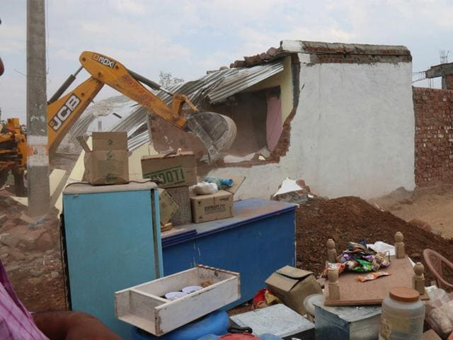 A-building--being-razed-during-the-demolition-drive-in-Kolar-s-Mahawadiya-area-in-Bhopal-on-Friday-HT-photo