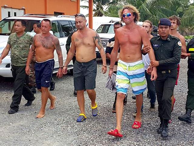 Russian-tycoon-Sergei-Polonsky-escorted-by-Cambodian-military-police-officials-in-Preah-Sihanouk-province-AFP-Photo
