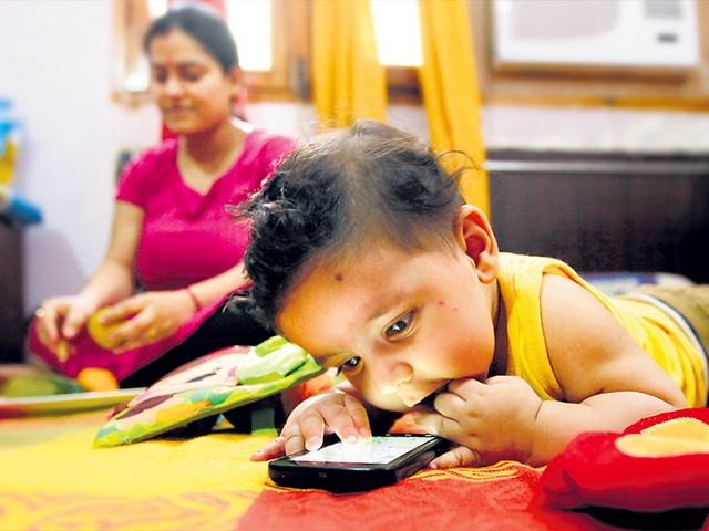 Five-month-old-Aayansh-Mukul-struggles-to-hold-his-mother-s-smartphone-in-his-tiny-hands-but-is-still-always-grabbing-at-it-He-then-stares-at-the-screen-without-blinking-It-worries-me-says-his-mother-Roshima-Raj-K-Raj-HT-Photo