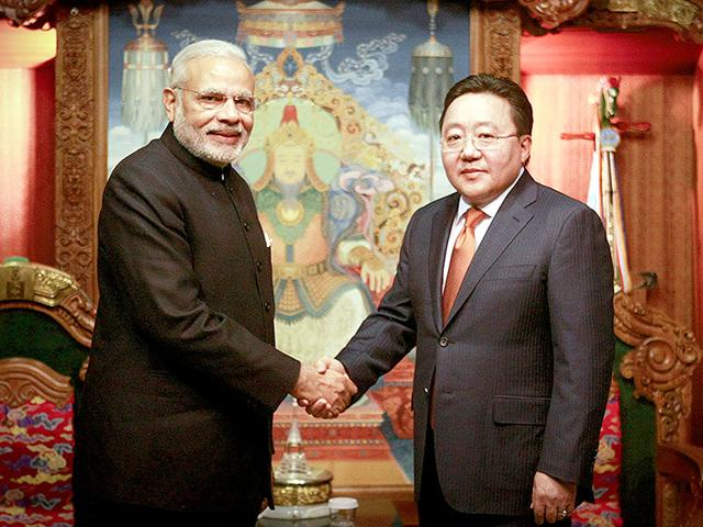 Prime-Minister-Narendra-Modi-with-and-Mongolia-s-minister-of-foreign-affairs-Lundeg-Purevsuren-R-after-arriving-at-the-Chinggis-Khaan-International-Airport-in-Ulan-Bator-AFP-Photo