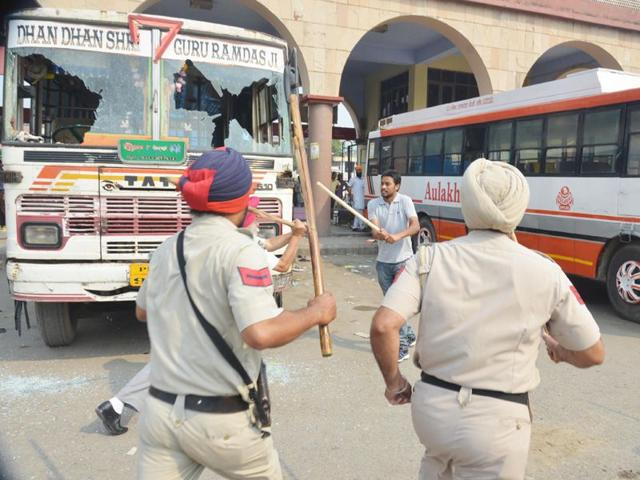 Punjab-police-resort-to-a-lathicharge-after-clash-between-two-groups-of-bus-operators-unions-at-bus-stand-in-Amritsar-Sameer-Sehgal-HT
