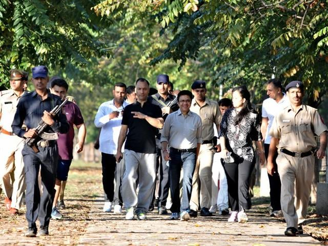 Surrounded-by-security-personnel-UT-adviser-Vijay-Kumar-Dev-and-other-officials-take-a-walk-at-Sukhna-Lake-Chandigarh-residents-often-complain-about-civil-servants-not-being-easily-accessibile-Giving-a-patient-hearing-to-the-people-and-involving-the-civil-society-in-policymaking-can-go-a-long-way-in-winning-their-confidence-HT-file-photo