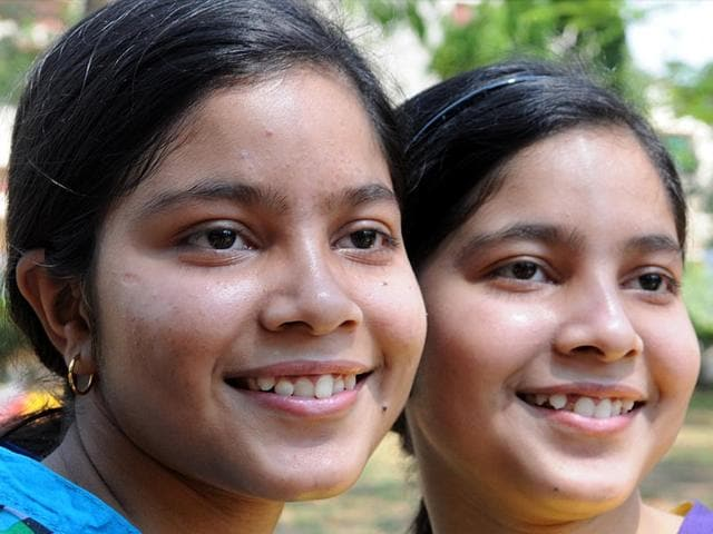 Aporupa-and-Anorupa-Chattopadhyay-twin-sisters-from-Ranchi-topped-from-Loreto-Convent-by-securing-97-80-and-98-marks-respectively-in-the-ICSE-Class-10-results-declared-on-Monday-They-also-have-the-same-marks-in-five-out-of-six-subjects