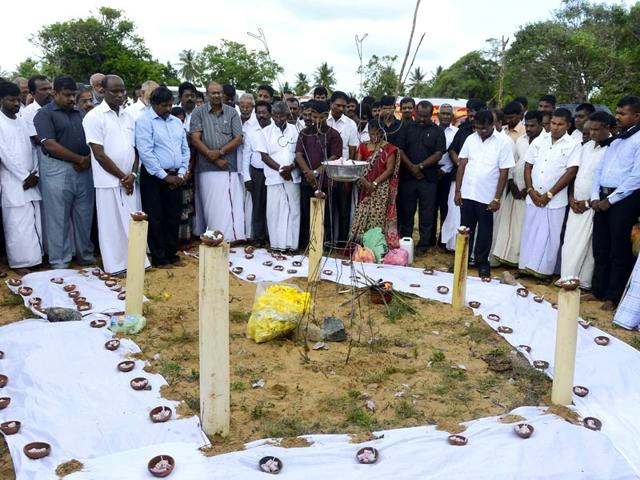 Sri-Lankan-Tamils-take-part-in-a-ceremony-at-Mullaivaukkal-on-the-outskirts-of-Jaffna-in-commemoration-of-those-who-died-six-years-ago-in-battles-between-Liberation-Tigers-of-Tamil-Eelam-LTTE-fighters-and-government-troops-at-the-end-of-the-three-decades-old-separatist-conflict-AFP-Photo