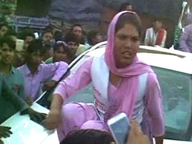 Sadhvi-Pandey-on-top-of-SP-leader-Mercedes-after-being-winked-at