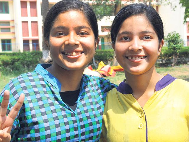 Twin-sisters-Anorupa-and-Aporupa-celebrate-their-success-in-Ranchi-on-Monday-HT-Photo