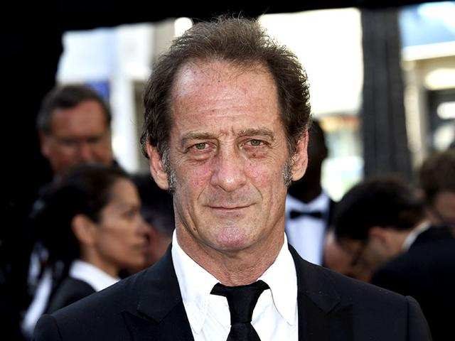 French-actor-Vincent-Lindon-poses-before-leaving-the-festival-palace-after-the-screening-of-the-film-La-Loi-du-Marche-The-Measure-of-a-Man-at-the-68th-Cannes-Film-Festival-in-Cannes-France-on-May-18-2015-AFP