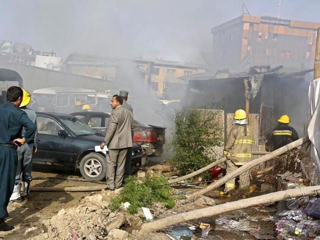 Afghan-security-forces-investigate-the-site-of-a-bomb-blast-in-Kabul-A-bomb-exploded-in-the-parking-lot-of-Afghanistan-s-ministry-of-justice-on-Tuesday-as-civil-servants-were-leaving-work-for-the-day-Reuters