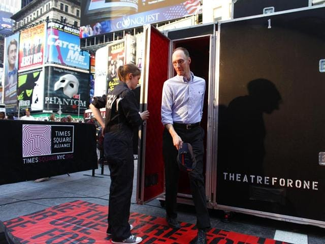 An-audience-member-steps-out-of-the-Theatre-for-One-performance-space-in-New-York-s-Times-Square-Theatre-for-One-a-4-foot-by-8-foot-portable-theater-allows-one-audience-member-at-a-time-to-see-one-short-play-performed-by-a-single-actor-AP-Photo