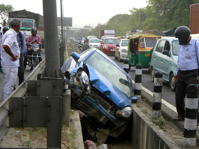 A-car-fall-down-in-drain-after-the-sudden-dust-storm-at-service-road-near-NH-8-between-Rao-Tula-Marg-and-Mahipalpur-in-New-Delhi-Sanjeev-Verma-HT-Photo