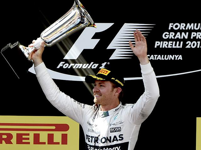 Mercedes-AMG-Petronas-F1-Team-s-German-driver-Nico-Rosberg-celebrates-on-the-podium-after-the-Spanish-Formula-One-Grand-Prix-at-the-Circuit-de-Catalunya-in-Montmelo-on-the-outskirts-of-Barcelona-AFP-PHOTO