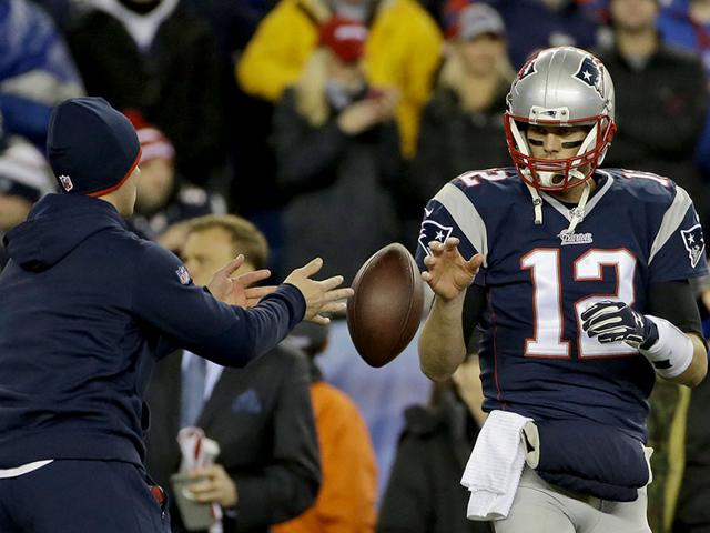 New-England-Patriots-quarterback-Tom-Brady-has-a-ball-tossed-to-him-during-warmups-before-the-NFL-football-AFC-Championship-game-against-the-Indianapolis-Colts-in-Foxborough-Mass-AP-Photo