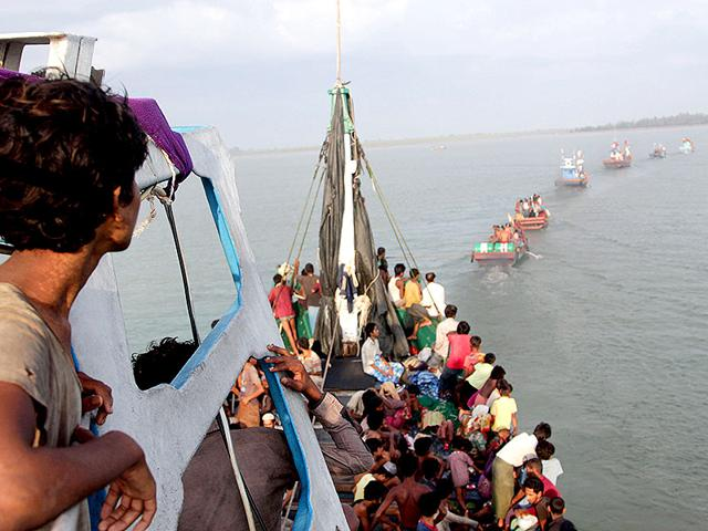 A-Rohingya-migrant-crying-as-he-sits-with-others-in-a-boat-drifting-in-Thai-waters-off-the-southern-island-of-Koh-Lipe-in-the-Andaman--Trafficking-experts-say-Thailand-is-the-centre-of-a-multi-million-dollar-trade-run-by-competing-transnational-criminal-syndicates-AFP-Photo
