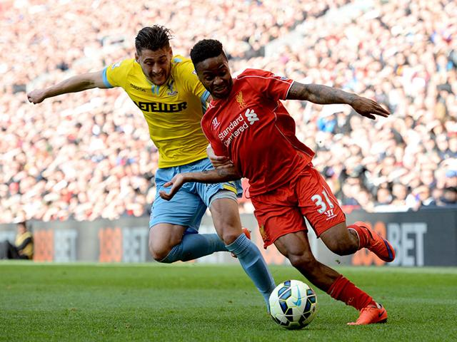 Liverpool-s-English-midfielder-Raheem-Sterling-takes-on-Crystal-Palace-s-English-defender-Joel-Ward-during-the-English-Premier-League-football-match-between-Liverpool-and-Crystal-Palace-at-the-Anfield-stadium-in-Liverpool-AFP-PHOTO