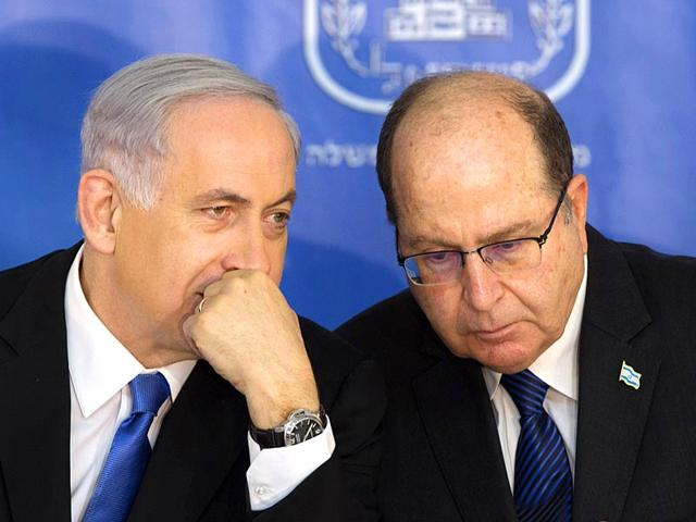 File-photo-of-Israeli-PM-Benjamin-Netanyahu-amp-Defense-Minister-Moshe-Yaalon-Netanyahu-has-called-off-a-proposed-plan-to-segregate-Palestinians-from-Israelis-on-West-Bank-buses-overruling-his-defense-minister-AP-Photo