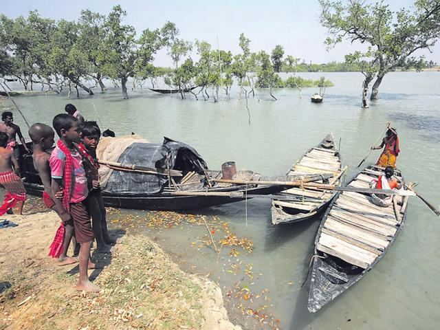In-the-absence-of-proper-administration-either-from-the-Indian-side-or-the-Bangladeshi-neighbour-life-is-a-constant-struggle-for-people-who-depend-on-the-Sunderbans-for-their-survival-Samir-Jana-HT-File-Photo
