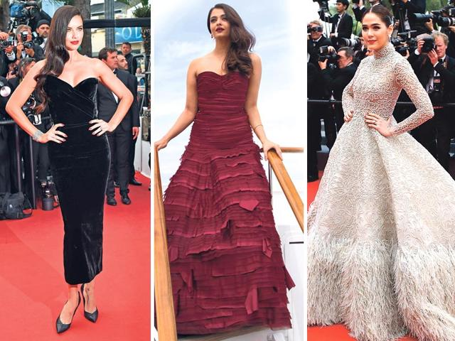 While-Adriana-Lima-and-Araya-Hargate-cast-a-spell-with-their-black-ensemble-and-feathered-gown-Aishwarya-Rai-Bachchan-stood-out-with-her-maroon-strapless-Oscar-de-la-Renta-gown